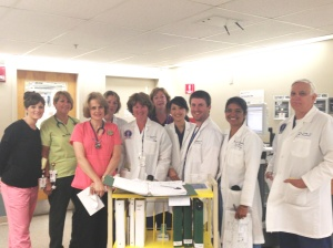 The Trauma Rounding Team: (L to R) Erin Borowiec, RN, Donna Parella, RN, Rachel David, RN, Jennifer Osborne, NP, Lisa McNamara, NP, Laurie Hayes, RN, Sook Chan, MD, Dan Hetherman, MD, Heena Santry, MD, Timothy Emhoff, MD